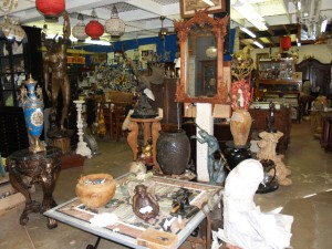 antiques in williamsburg va, including antique mirrors, antique vases, antique porcelain vases, bronze statue, handcarved antique mirror, handcarved antique bedstead